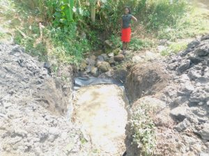The Water Project:  Field Officer Checks Progress