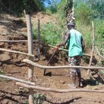 The Water Project: Musango Community, Mushikhulu Spring -  Finishing The Fence