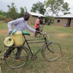 The Water Project: Mukhuyu Community, Kwawanzala Spring -  Man Transporting Water