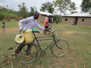 The Water Project:  Man Transporting Water