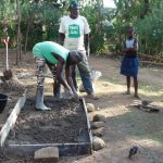 The Water Project: Musango Community, Mushikhulu Spring -  Sanitation Platform Construction