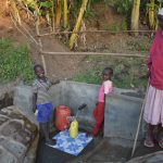 The Water Project: Munenga Community, Burudi Spring -  Grandmother Watching Grandchildren