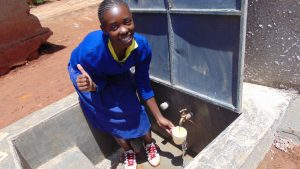 The Water Project:  Jane Emali Enjoys Flowing Water From The Tank