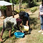 The Water Project: Shihingo Community, Mangweli Spring -  Handwashing Teamwork