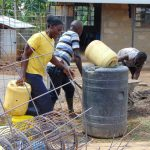 The Water Project: Musasa Secondary School -  Carrying Water For Cement