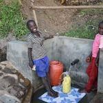 The Water Project: Munenga Community, Burudi Spring -  Drawing Water