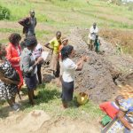 The Water Project: Munenga Community, Burudi Spring -  Trainer Lynnah Leads Handwashing Activity