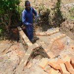 The Water Project: Eshiakhulo Community, Kweyu Spring -  Fitting The Pipe