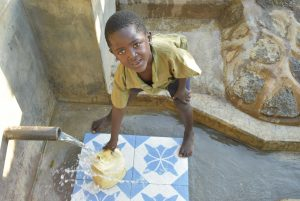 The Water Project:  Young Boy Fecthes Water