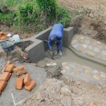 The Water Project: Eshiakhulo Community, Kweyu Spring -  Smoothing The Cement
