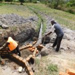The Water Project: Shihingo Community, Mangweli Spring -  Adding Cement