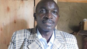 The Water Project:  Headteacher Mr Amatsimbi Ababu