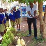 The Water Project: Kima Primary School -  Officer Samuel Demonstrating Handwashing At A Tippy Tap