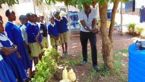 The Water Project:  Officer Samuel Demonstrating Handwashing At A Tippy Tap