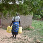 The Water Project: Kaketi Community A -  Carrying Water At Home