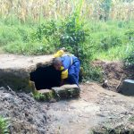 The Water Project: Ibwali Primary School -  Student Fecthing Water In A Covered Spring
