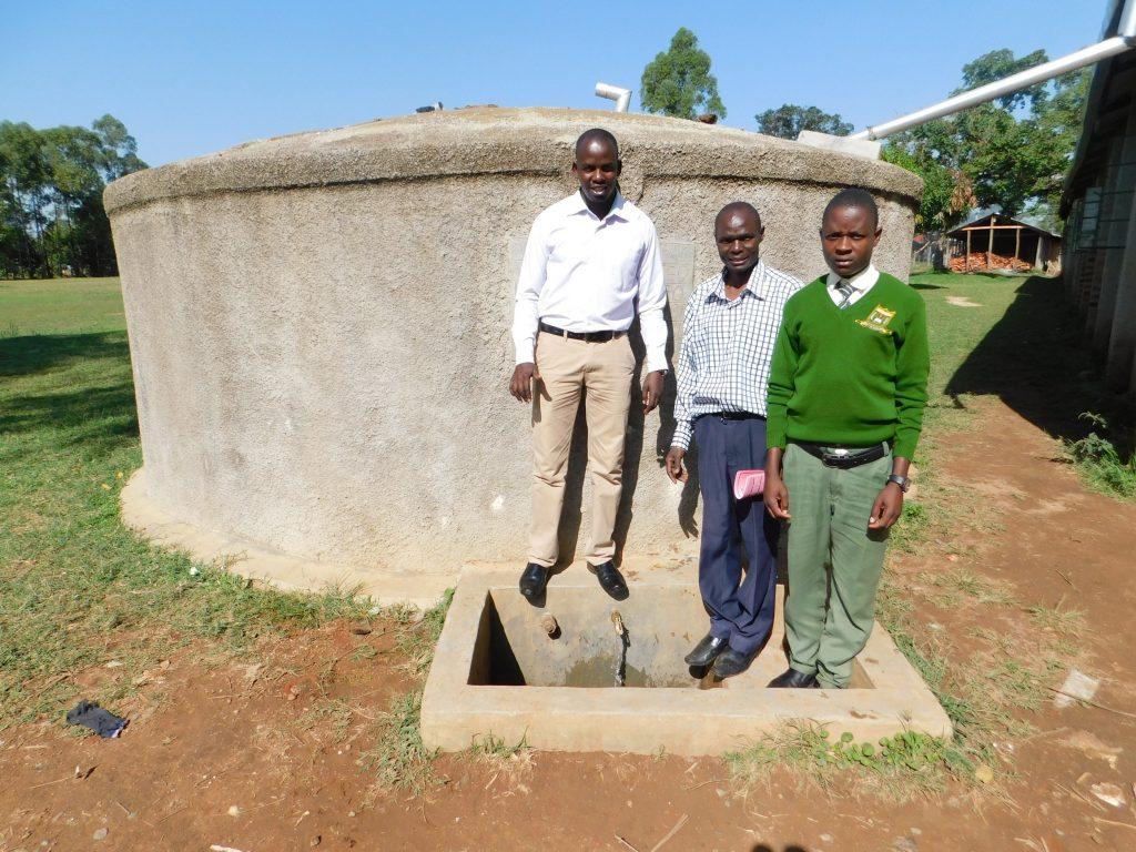 The Water Project : 1-kenya18048-field-officer-jonathan-deputy-principal-titus-wanyama-and-student-julius-oyemba