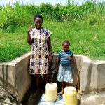 The Water Project: Musango Community, Dawi Spring -  Water Flowing