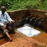 The Water Project: Shilakaya Community, Shanamwevo Spring -  John Sits For His Interview