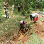 The Water Project: Wajumba Community, Wajumba Spring -  Digging Drainage