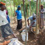 The Water Project: Musango Community, Emufutu Spring -  Women Gathering Sand