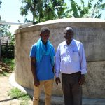 The Water Project: Imuliru Primary School -  Field Officer Ian With Mr Lwangu