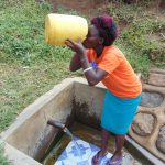 The Water Project: Musango Community, Ham Mwenje Spring -  Violet Takes A Drink