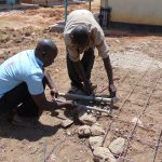 The Water Project: Namanja Secondary School -  Affixing The Discharge Pipes