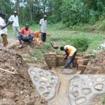 The Water Project: Wajumba Community, Wajumba Spring -  Bricking