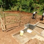 The Water Project: Wajumba Community, Wajumba Spring -  Buliding The Fence