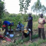 The Water Project: Musango Community, Emufutu Spring -  Community And Artisan Sharing A Meal