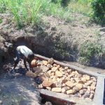 The Water Project: Musango Community, Emufutu Spring -  Back Filling