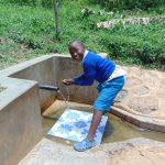 The Water Project: Ivulugulu Community, Ishangwela Spring -  Lewi Anjawa
