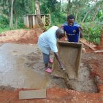 The Water Project: Kitumba Primary School -  Pouring Cement