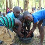 The Water Project: Musango Community, Emufutu Spring -  Children Demonstrating How They Normally Wash Hands