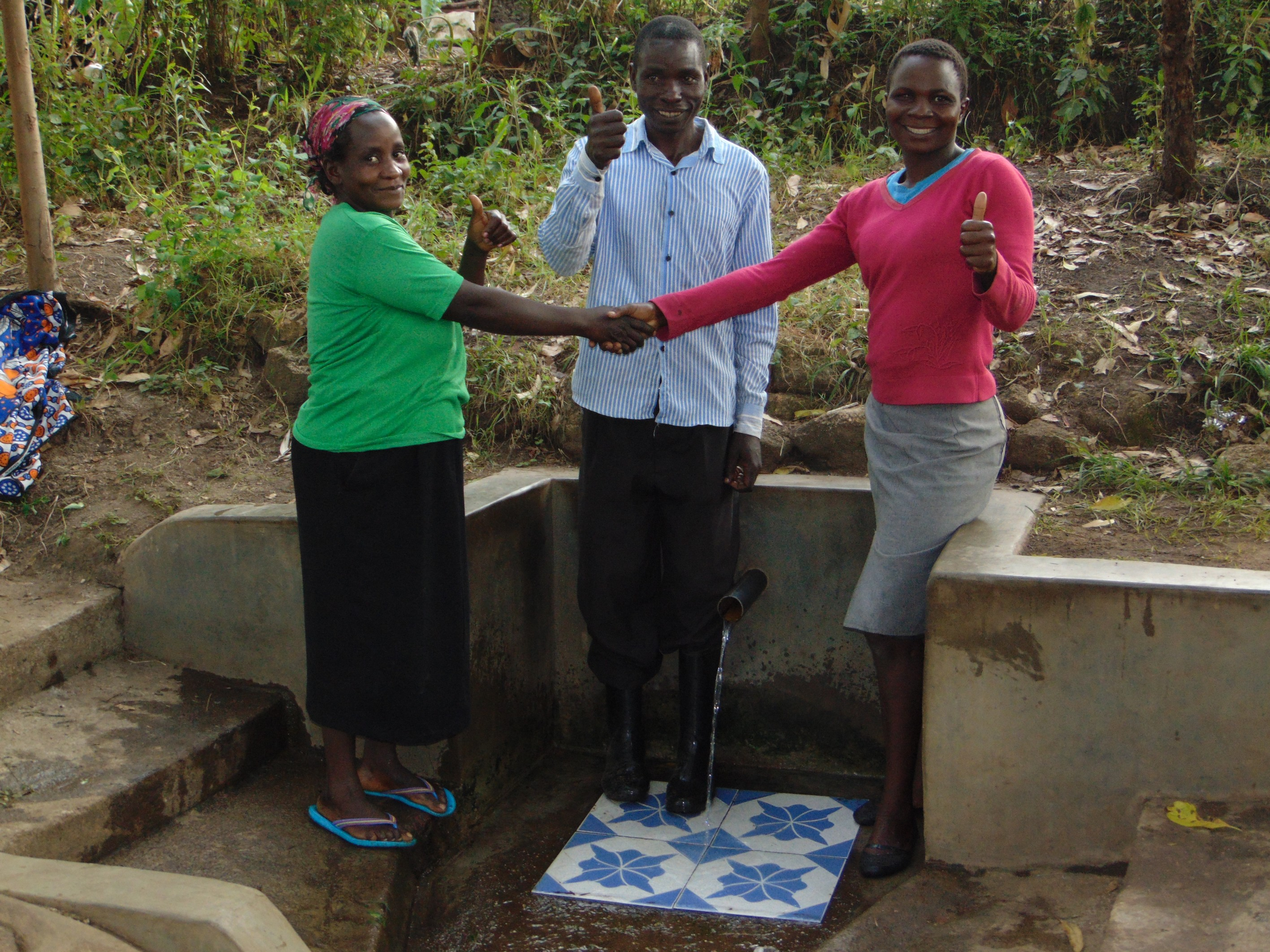 The Water Project : 4-kenya18097-thumbs-up-for-running-water