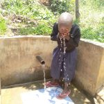 The Water Project: Sharambatsa Community, Mihako Spring -  Taking A Drink