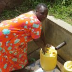 The Water Project: Futsi Fuvili Community, Simeon Shimaka Spring -  Jacklyne Fetches Water