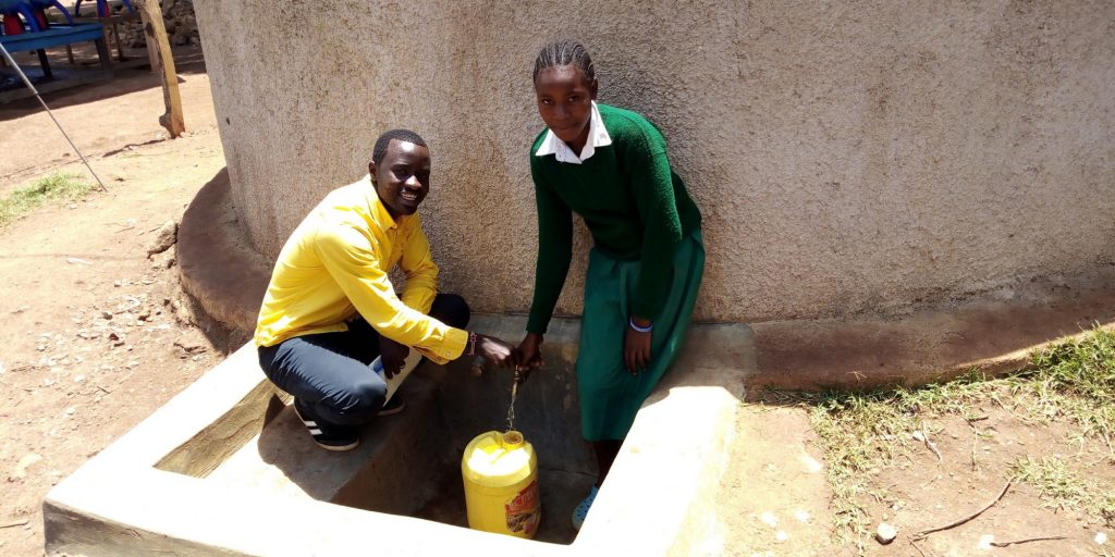 The Water Project : 5-kenya18016-field-officer-erick-and-angela
