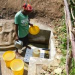 The Water Project: Sambuli Community, Nechesa Spring -  Fetching Water