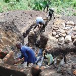 The Water Project: Eshiasuli Community, Eshiasuli Spring -  Digging Diversion Channel