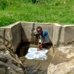 The Water Project: Musango Community, Dawi Spring -  Washing Up
