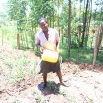 The Water Project: Elukuto Community, Isa Spring -  Watering Crops