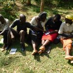 The Water Project: Wajumba Community, Wajumba Spring -  Discussing And Taking Notes