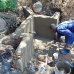The Water Project: Eshiasuli Community, Eshiasuli Spring -  Adding Cement