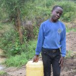 The Water Project: Mwau Community A -  Asdf_kianguni Shgir_person Carrying Water