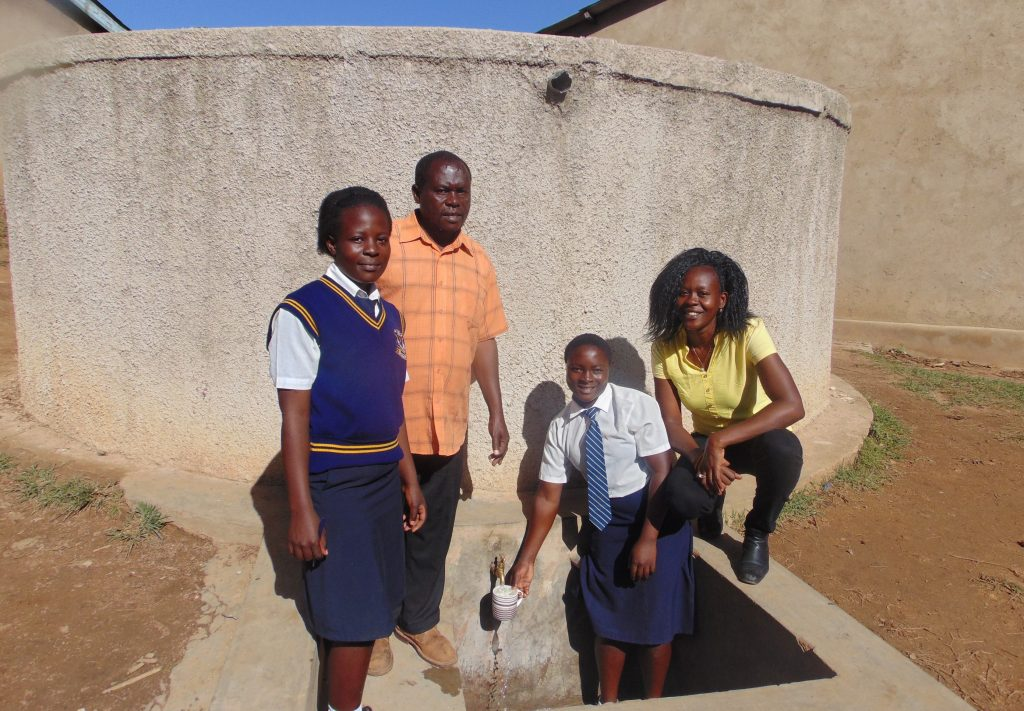 The Water Project : 3-kenya18011-filling-up-and-smiles