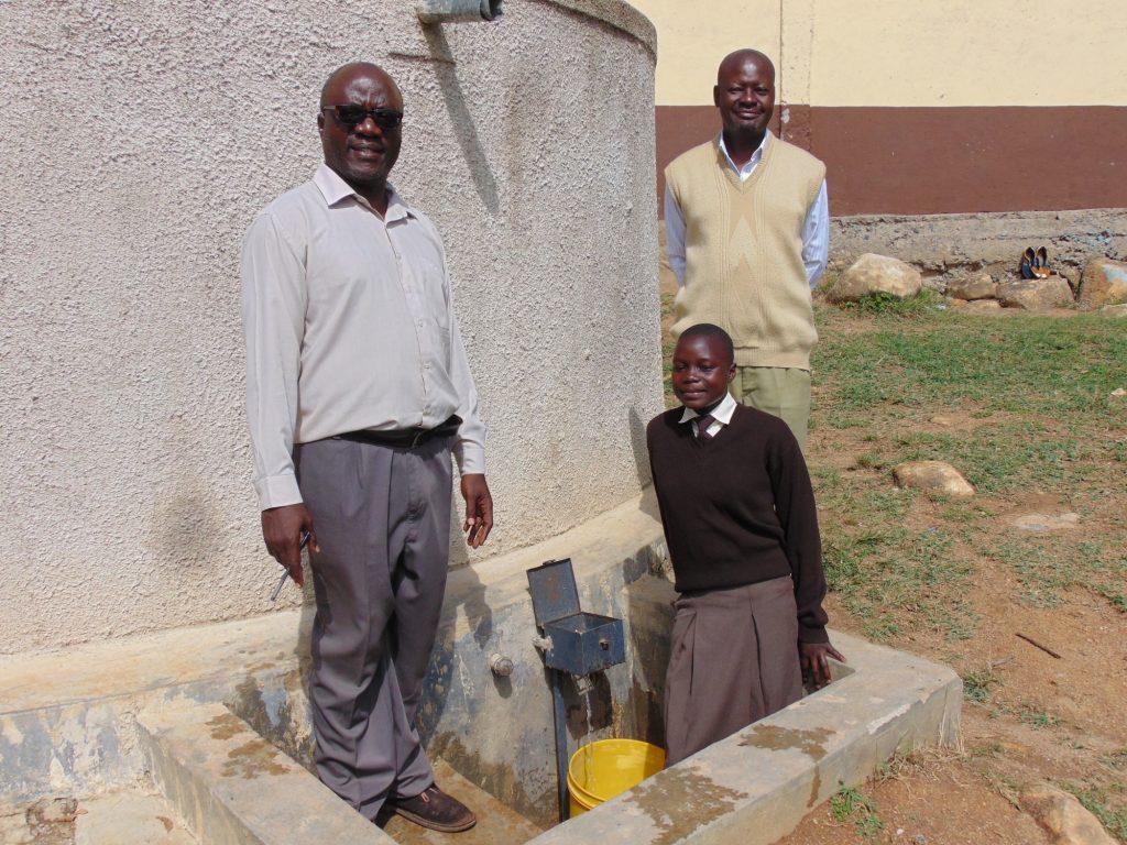 The Water Project : 3-kenya18022-deputy-principal-principal-and-student-pauline