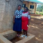 The Water Project: Munyanda Primary School -  Field Officer Betty With Sanitation Teacher Carolyne Avungana