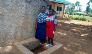 The Water Project:  Field Officer Betty With Sanitation Teacher Carolyne Avungana